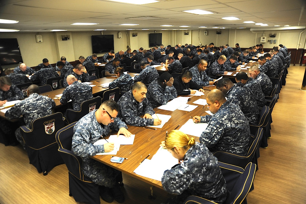 SAN DIEGO (Jan. 15, 2014) Petty officers take the E7 advancement examination in the wardroom of Wasp-class amphibious assault ship USS Essex (LHD 2). The exam, which tests rating and basic military knowledge, will be taken by approximately 17,000 E6's throughout the fleet this cycle. (U.S. Navy photo by Mass Communication Specialist 2nd Class Christopher B. Janik/Released)
